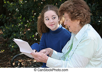 Grandma Sharing Wisdom - A young girl discussing homework...