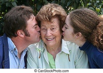 Kiss For Grandma - A sweet grandmother receiving kisses from...