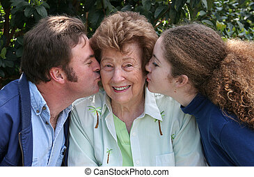Kisses and Smiles - A pretty grandmother receiving kisses...