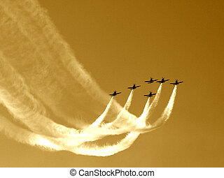 Synchronized team flight- flying in formations. Toned