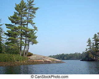 Rocky lake shore - rocky of shoreline of northern lake