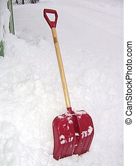 Snow shovel left in the snow