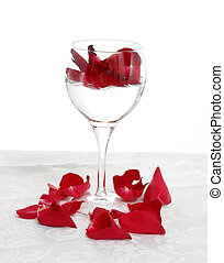rose petals - red rose petals in a wine glass