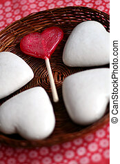 heart shaped cookies - cookies and red lollipop on a fancy...