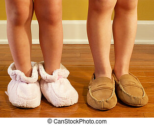 kids with slippers - children\\\'s legs with slippers on...
