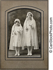 communion - Victorian portrait of two girls in first holy...