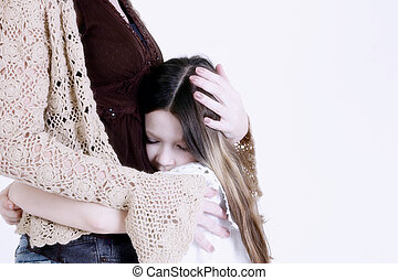 Child hugging mom - Young girl hugging mom with white...