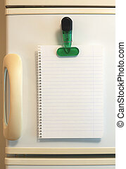 Blank shopping list on fridge