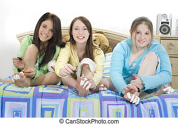 Pedicures Teen Girls - Three young teens doing self...