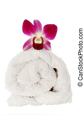 Orchid on Towel - Orchid flower on white towel