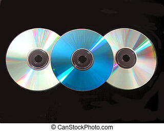 Three cd on black - Three compact disks on black background
