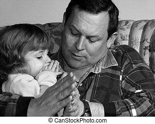 Learning to Pray - Father teaching his little girl to pray