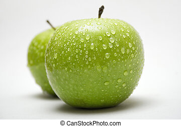 Green Apples wWater - Raindrops on two delicious green...