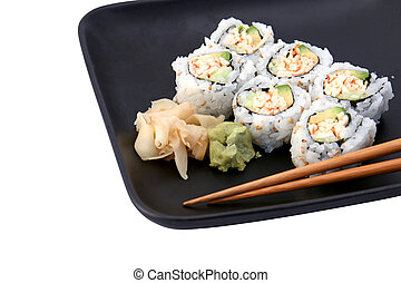 Sushi Roll Lunch - A sushi california roll on a black plate,...