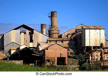 the old sugar mill - decaying sugar mill in western kauai a...