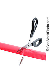 cutting through the red tape - black scissors cutting red...