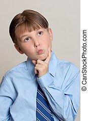 Thinking Boy - A boy with a thinking or pondering expression