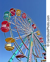 Ferris Wheel - A colorful Ferris Wheel against a perfect...