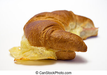 Croissant (SideView) - Croissant with ham and cheese against...