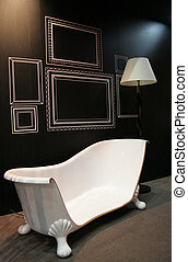 Abstract home decor - Cut off bathtub with a lamp in a...