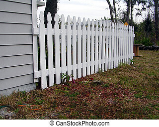 White Picket Fence - White picket fence of a house on a...