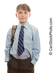 Schoolboy - Standing schoolboy with hands in pockets and...
