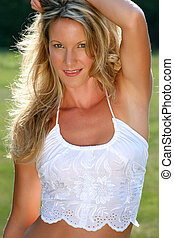 country girl - beautiful blonde model wearing white top...