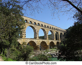 Pont du Gard is a famous Roman aquaeduct in the south of...