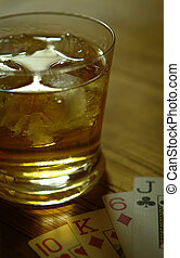 Whiskey glass - close up of whiskey glass and playing cards...