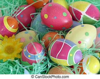 Easter Eggs - Closeup of several Easter eggs over green...
