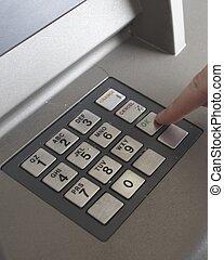 ATM OK - Finger pressing ATM OK button