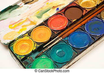 Box of Watercolors - Box of watercolors with two brushes on...
