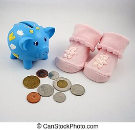 Savings Bank - A piggy bank, Canadian coins and a pair of...