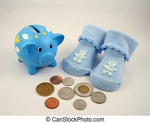 Bank for Baby - A pair of baby booties, a piggy bank and...