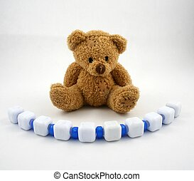 Bear and Beads - A teddy pair and a string of blue and white...