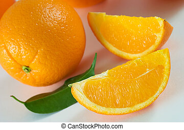 Oranges - Two slices of fresh orange and whole orange with...