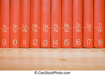Encyclopedia - Close view on red books standing in a wooden...