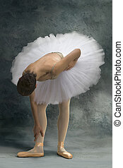 Ballerina in pain - Ballerina bends his body because of an...