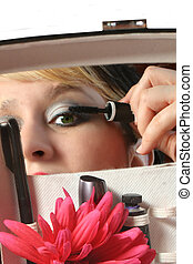 applying mascara - woman applies mascara