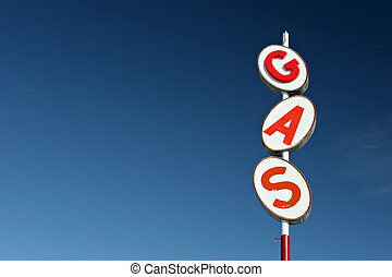 gas sign retro style, red white and blue, against blue sky...