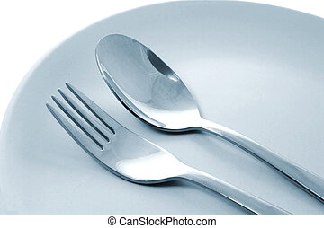 Fork and Spoon - Fork and spoon on plate
