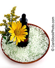 Spa Products - Essential oil, bath salts and flowers in a...