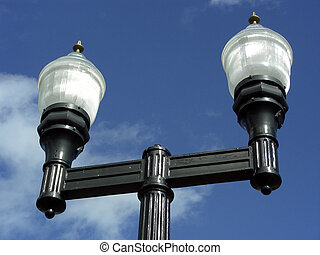 Sky Lights - Street lamps highlighted against the blue sky