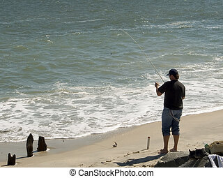 Surf Fisher - This is a shot of a man surf fishing at Sandy...