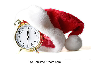Christmas time - isolated alarm clock with santa hat to show...