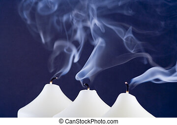 Blue Candle Smoke - candles with blue smoke after being...