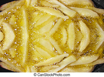 frying potatoes - potatoes frying in a pan, oil is hot and...