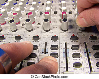 Mixing desk - Extreme close up of hands on a mixing desk