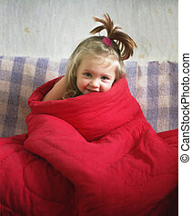 pretty girl - portrait of a little girl wraped up in the red...