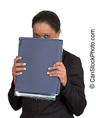 Shy - Woman hiding behind binder